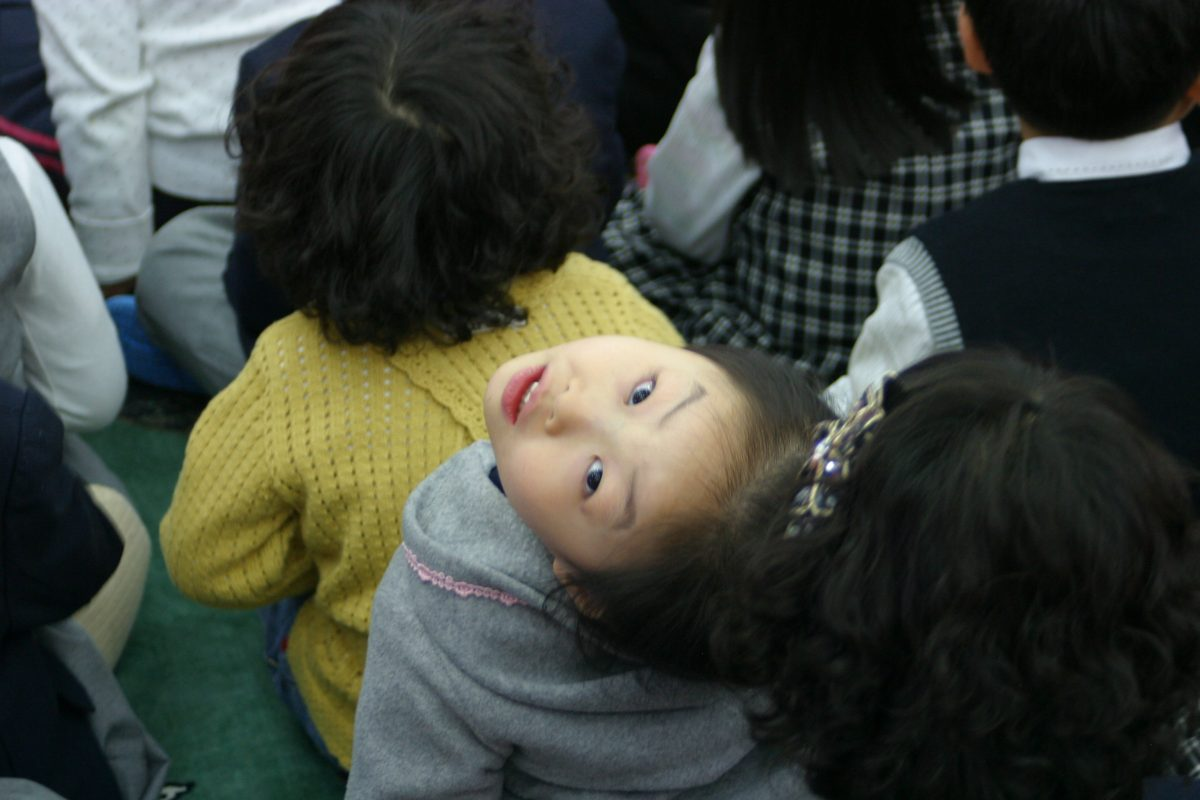 a korean child making a funny face