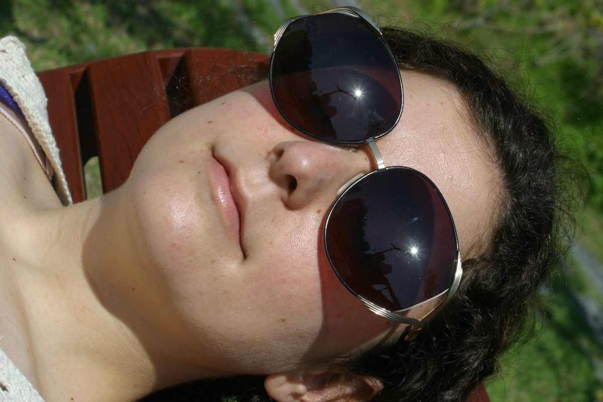 a woman wearing designer sunglasses