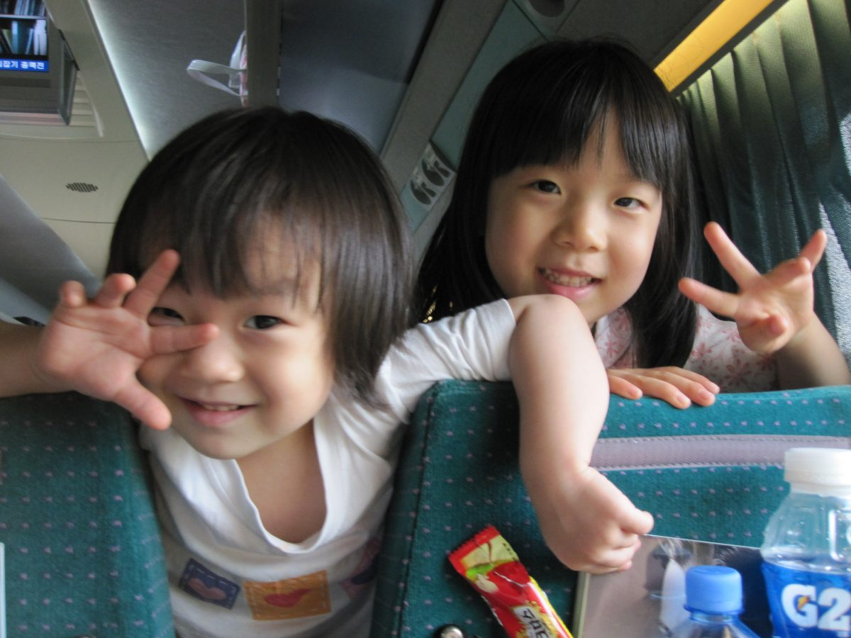 korean children giving peace sign with hands
