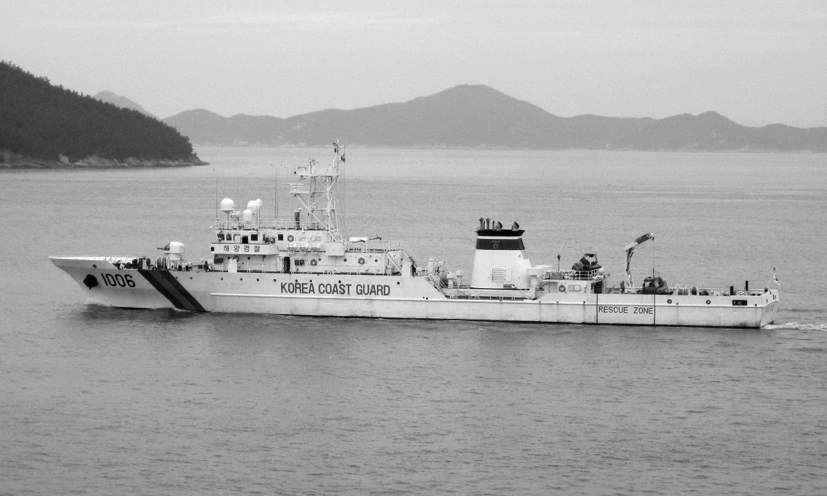a black and white photo of a korean coast guard cutter ship
