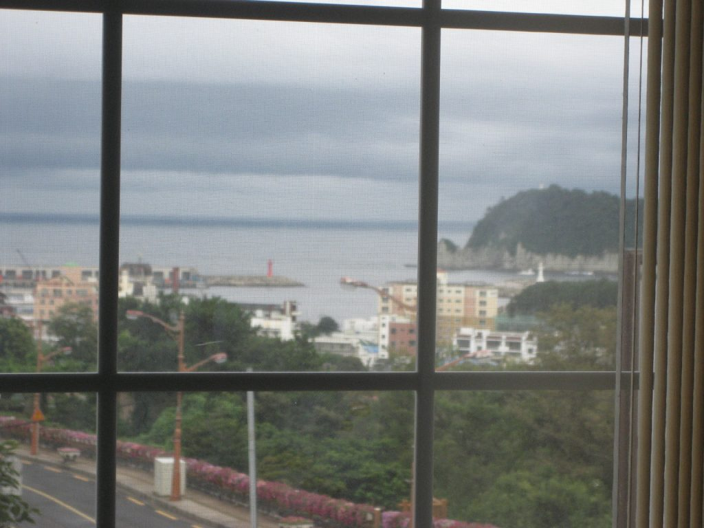 a daytime view of Seogwipo Harbor from a hostel nearby