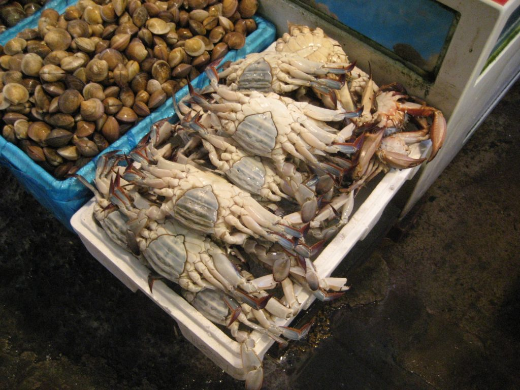 raw crabs, velly side up in a box