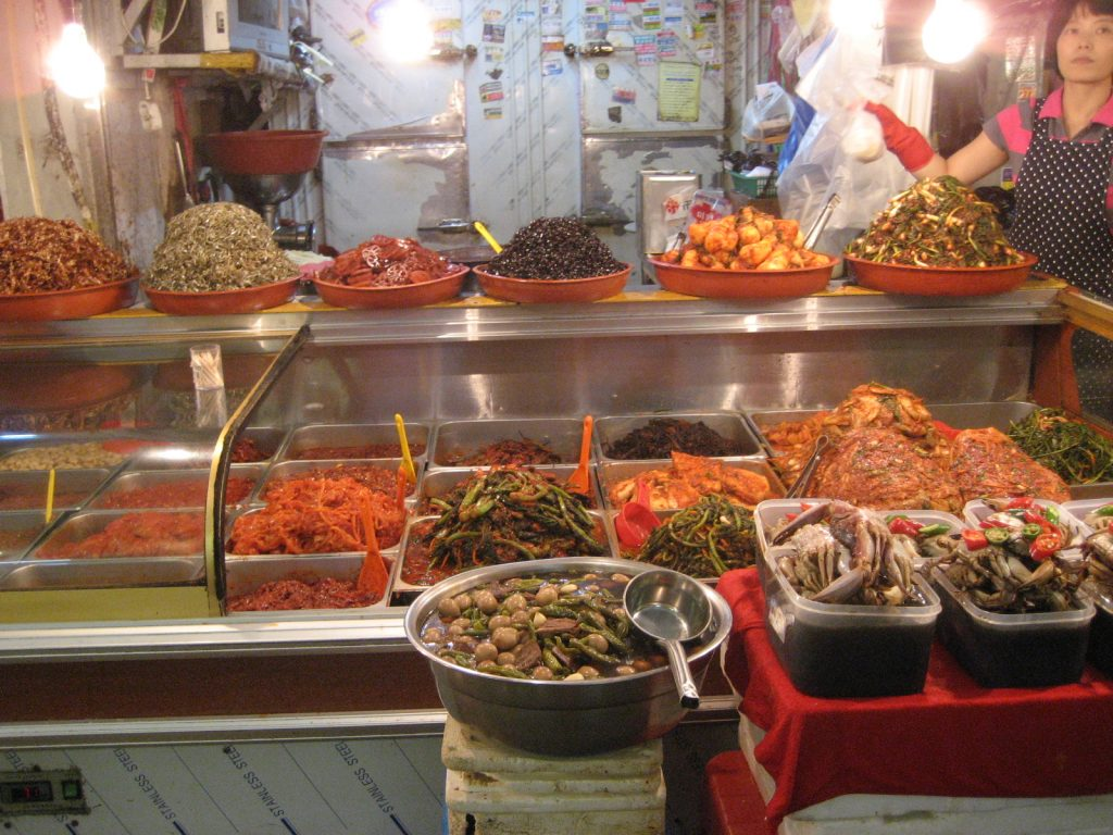 a deli style counter of pickled vegetables